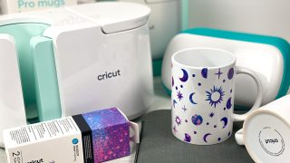finished cricut mug with infusible ink, cricut joy and cricut mug press in the background