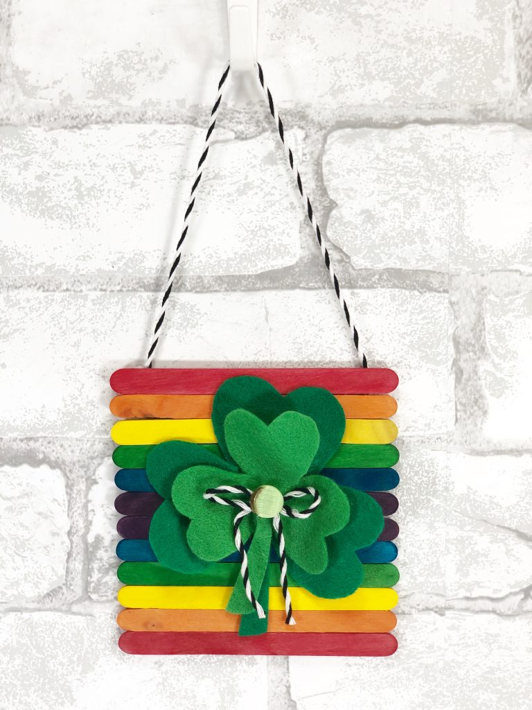 colorful shamrock wall hanging with supplies from dollar tree