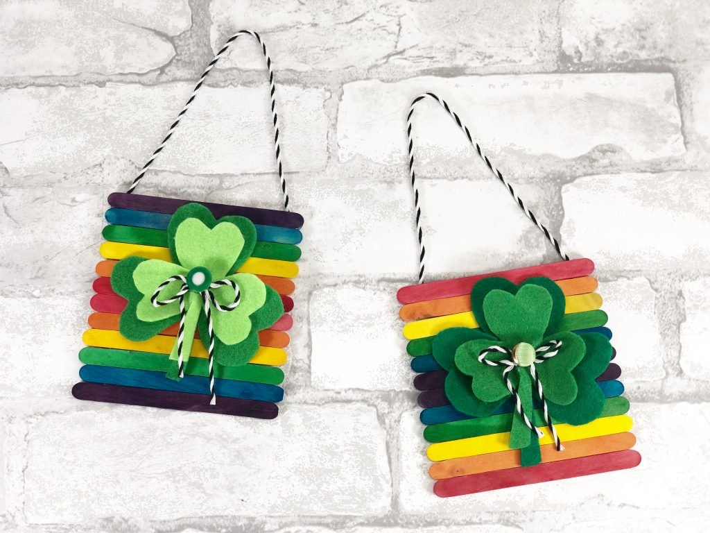 twp colorful shamrock wall hangings with supplies from dollar tree