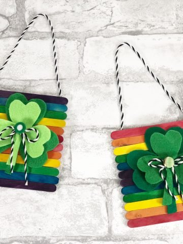 two colorful shamrock wall hangings with supplies from dollar tree