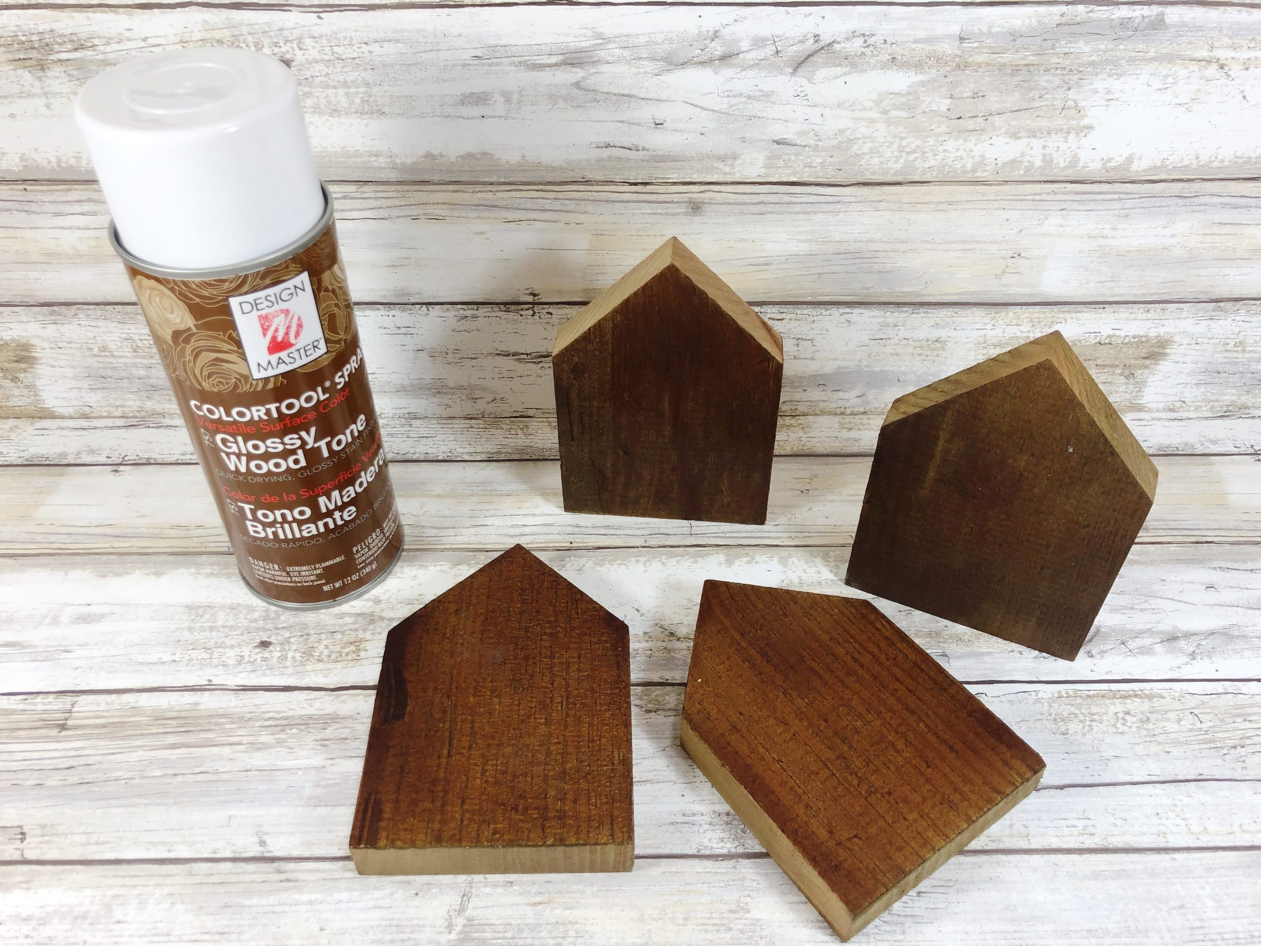 wood planks for home sign next to spray paint can