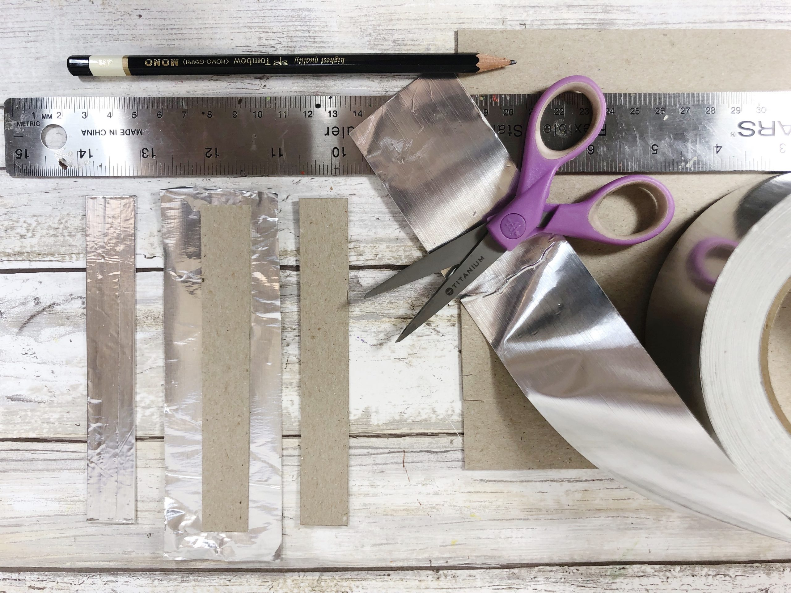 creating the roof of the home sign with slivers of silver