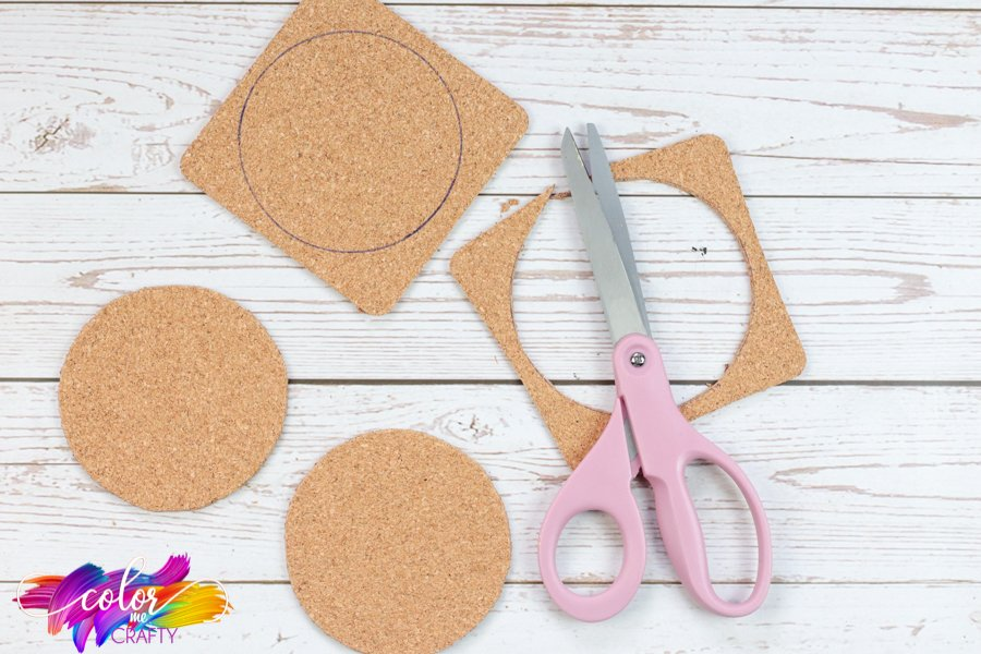 traced mason jar lids onto corks being cut out