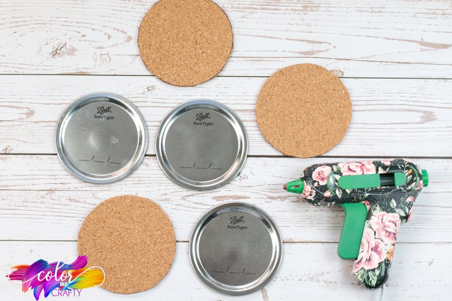 cut out corks the size of the mason jar lids