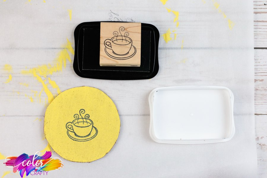 adding solid layer of black ink to stamp to stamp onto yellow cork