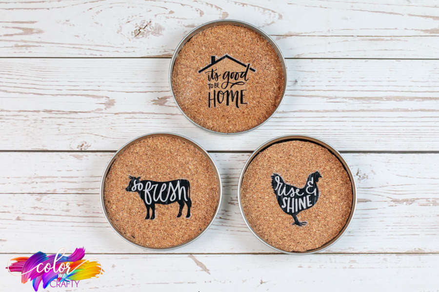 corks placed into mason jar lids with farmhouse stickers