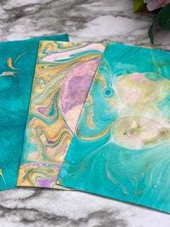 blue and pink and yellow marble paper on counter top