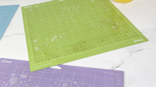 dirty vinyl cutting mats sprayed with totally awesome dollar tree spray