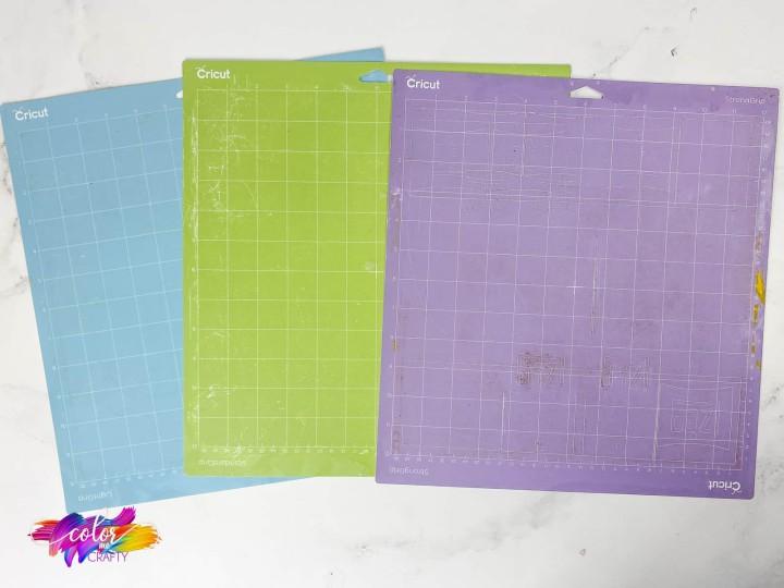 clean Cricut cutting mats, green standard grip, purple strong grip and blue light grip