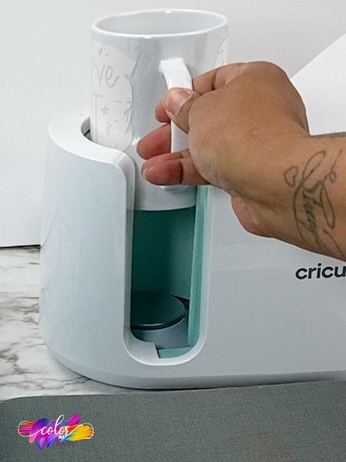 removing mug from the cricut mug press
