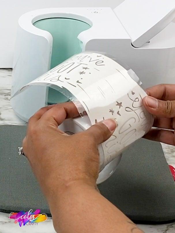 adding infusible ink transfer onto a cricut mug blank