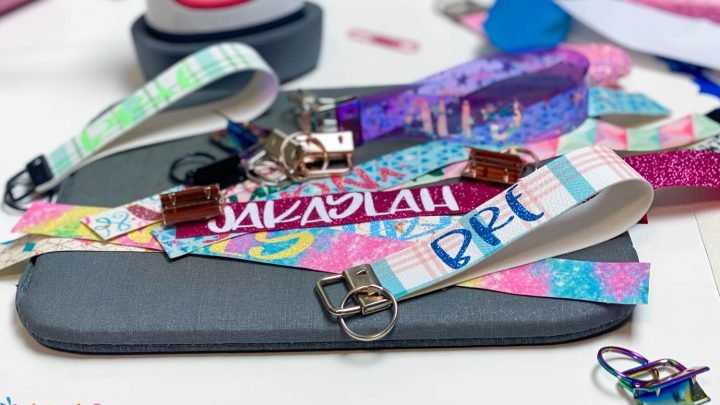 stack of cricut wristlet keychains with the easypress mini in the background