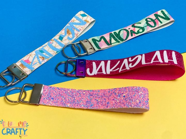 4 cricut wristlet keychains on a yellow and blue background