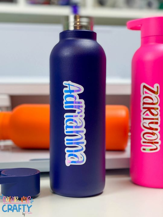 Navy blue water bottle with text adrianna