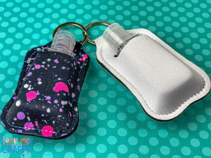 front overhead view of 2 hand sanitizer pouches made with infusible ink on a teal white background