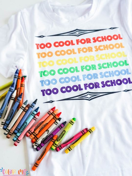 white sublimation t shirt that says too cool for school with crayons
