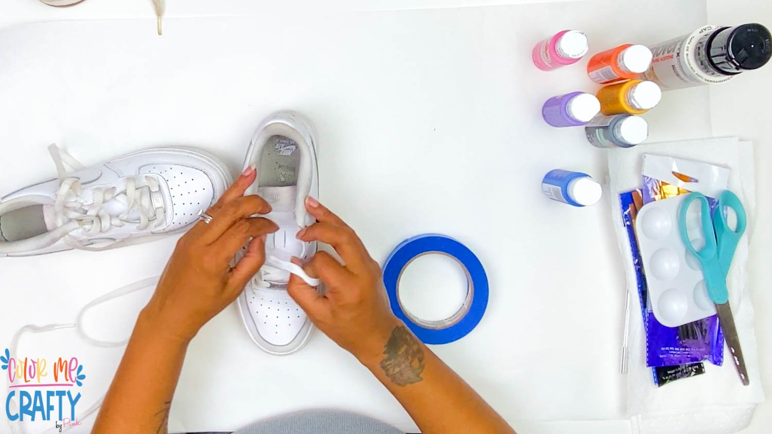 removing laces from shoes