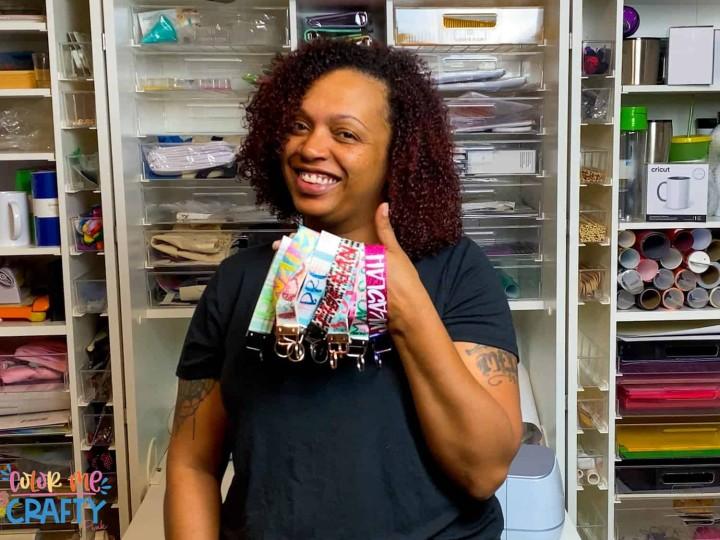 image of Jamela Payne holding keychains