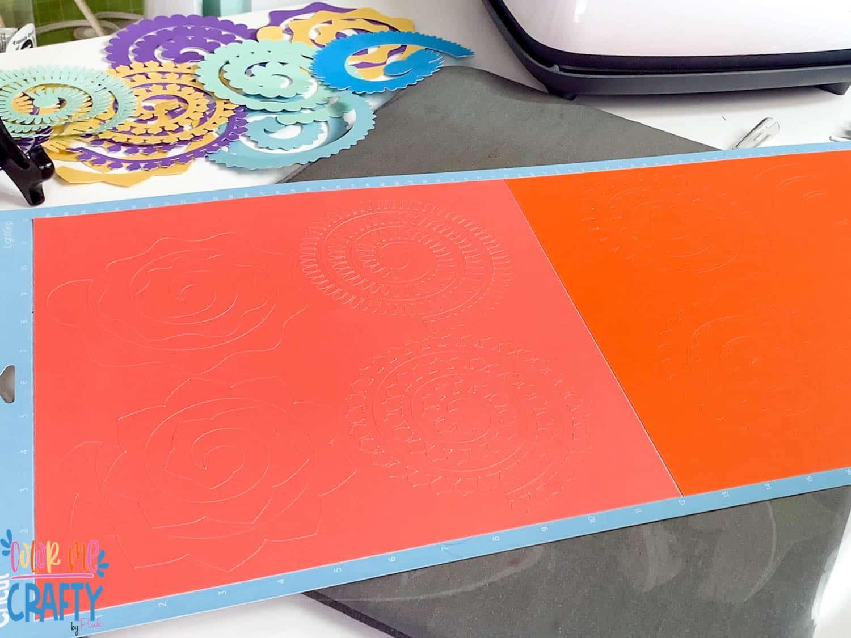 colorful paper on cricut mat