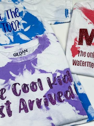 red, purple and blue Acrylic paint on a white shirt with words on it