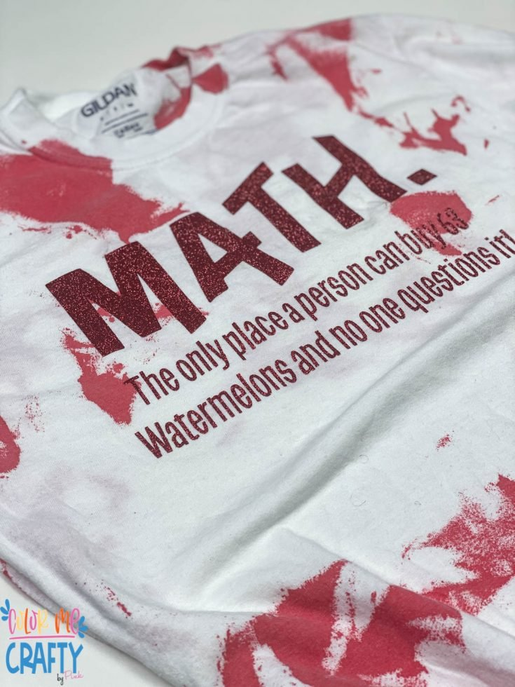 red Acrylic paint on a white shirt with words on it