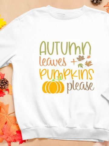 sweatshirt mock up with autumn leaves and pumpkins please on it