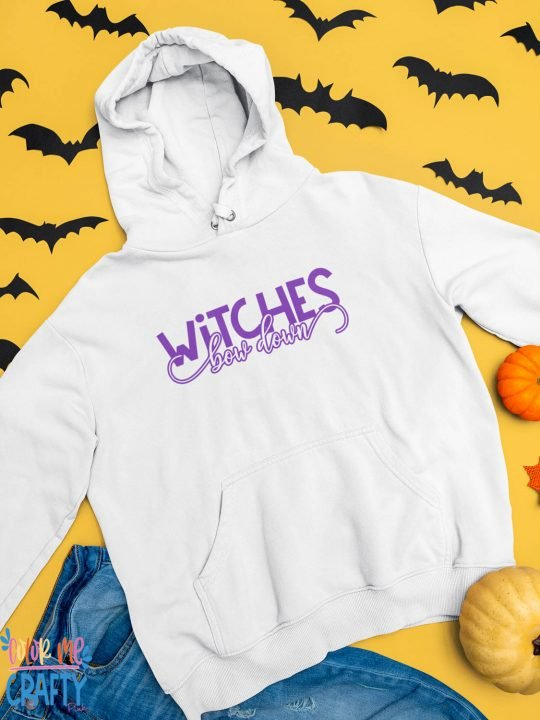 white sweatshirt that reads Witches Bow Down