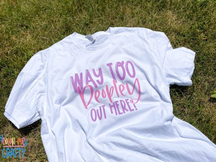 white shirt with color changing htv on it laying on the grass