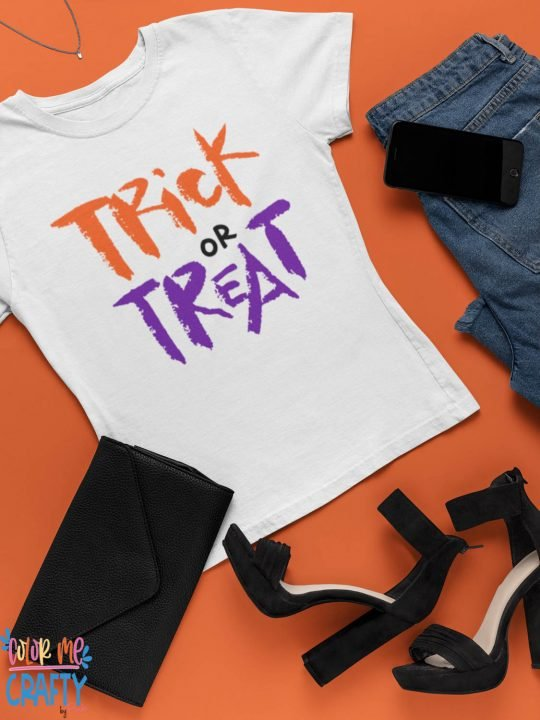 trick or treat svg on a white shirt with orange background