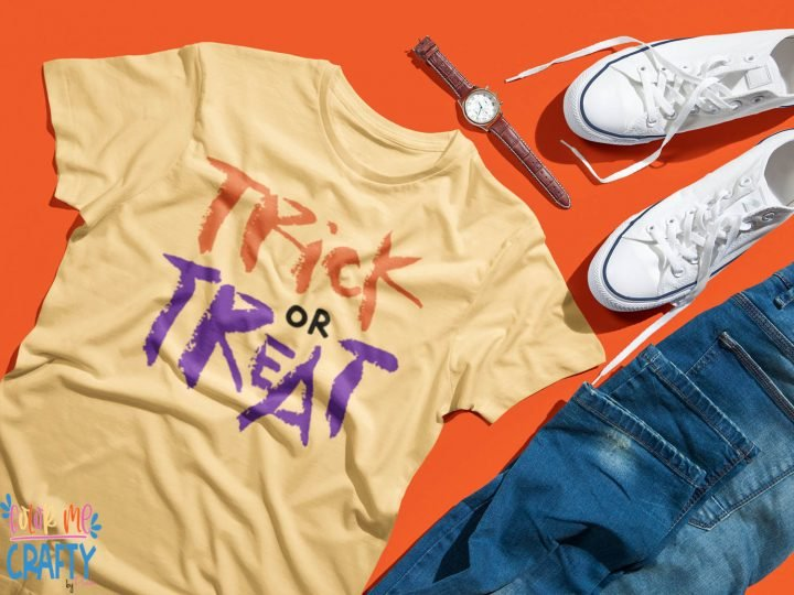 trick or treat svg on a yellow shirt with an orange background