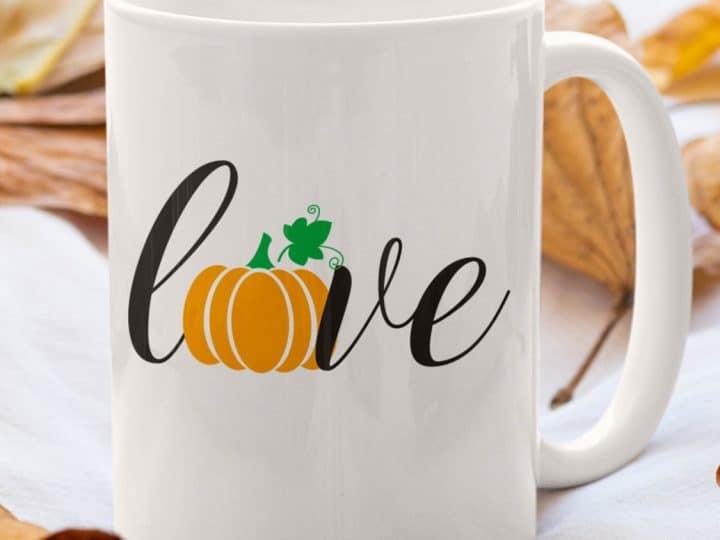 word love on a coffee mug and the o is a pumpkin
