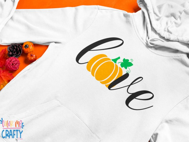 word love on a hoodie and the o is a pumpkin