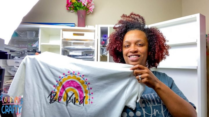 jamela payne holding shirt sublimated using siser easy subli with a pastel rainbow that says be kind